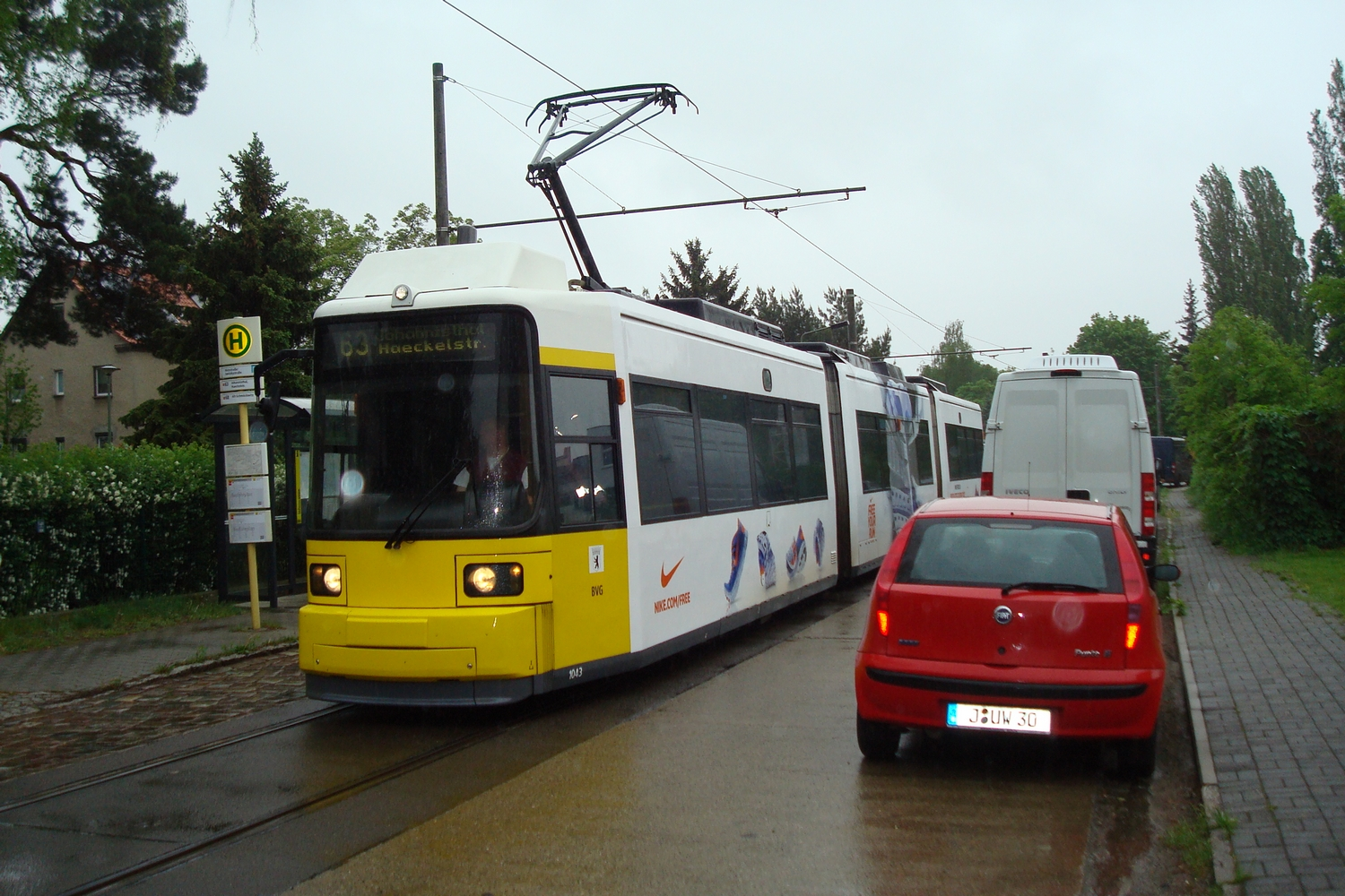 Berlin low-floor articulated tram 1043 on tram line 63 at the final destination Hirtestraße/Janitzkystraße (2013).  Berliner Verkehrsbetriebe (BVG). Low-floor articulated tram 1043, manufacturer AEG, type GT6N, serie 1, on tram line 63, in the direction towards Haeckelstraße, with advertising of Nike.