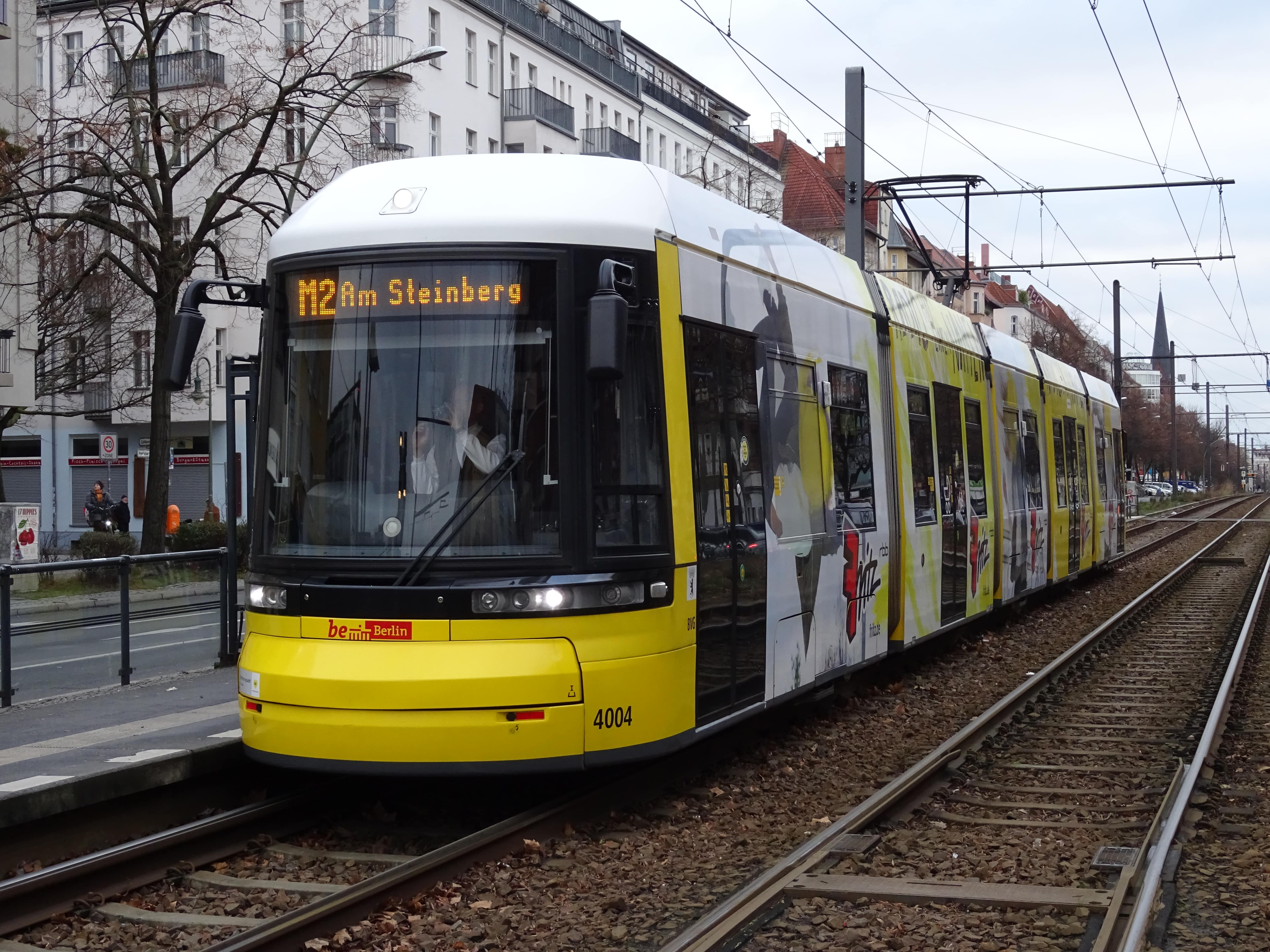 Berlin low-floor articulated tram 4004 on fast line M2 at the stop Prenzlauer Allee/Danziger Str. (2018).  Berliner Verkehrsbetriebe (BVG). Low-floor articulated tram 4004, manufacturer Bombardier, type F6Z, serie 4001-4034, on fast line M2 (2), in the direction towards Am Steinberg.