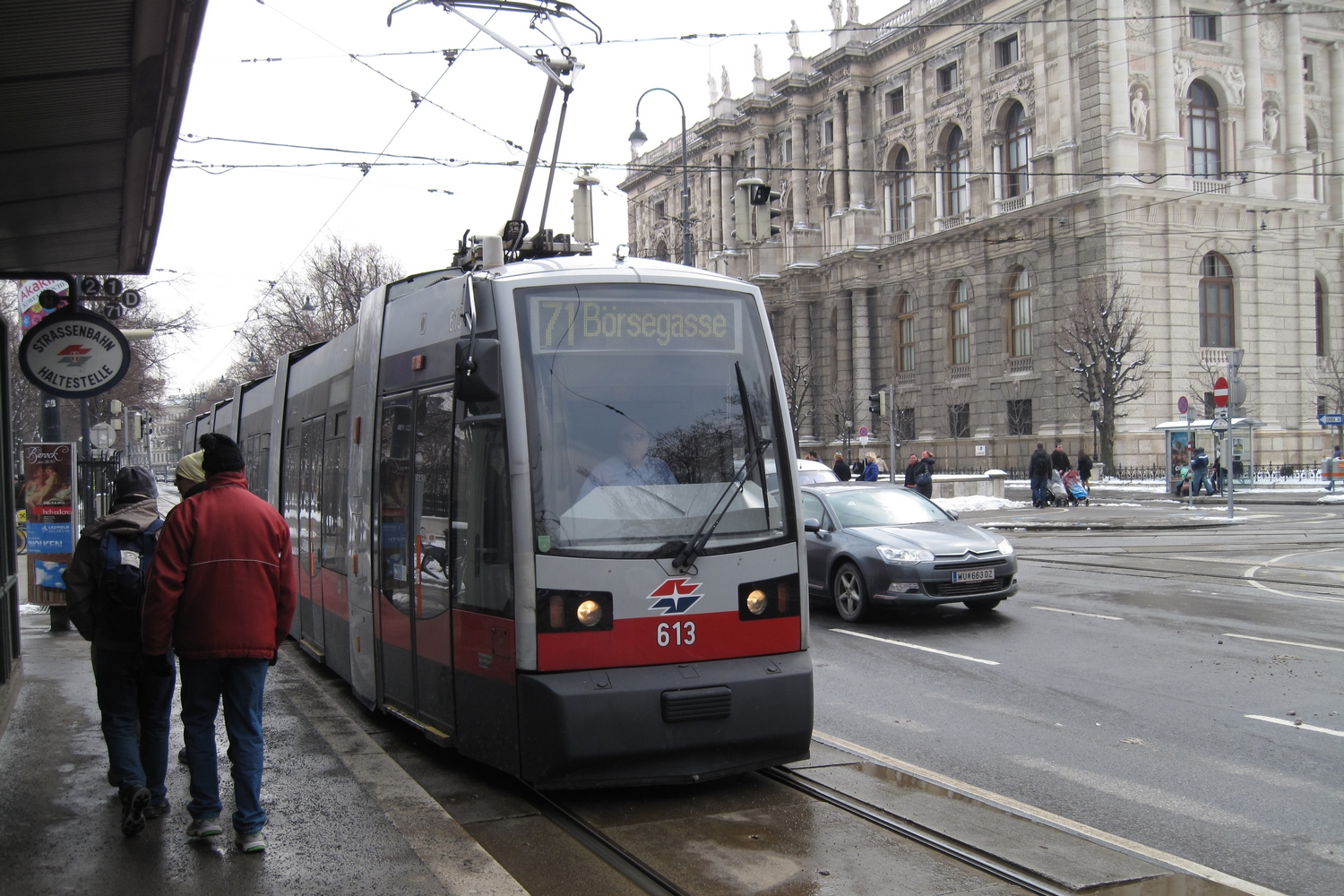 Vienna low-floor articulated tram 613 on tram line 71 at the stop Burgring (2013).