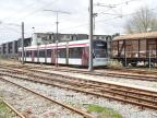 Aarhus low-floor articulated tram 1105-1205 on the side track at Odder Station, seen from the side (2020).