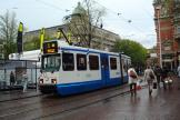 Amsterdam articulated tram 910 on tram line 5 at the stop Leidseplein (2011).