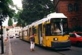 Berlin low-floor articulated tram 1054 on extra line 26 at the stop Freiheit, Köpenick (2001).