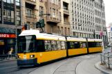 Berlin low-floor articulated tram 1055 on extra line 13 in the intersection Friedrichstraße/Oranienburger Straße (2002).