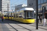 Berlin low-floor articulated tram 8023 on fast line M4 in the square Alexanderplatz (2012).