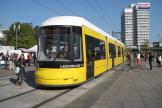 Berlin low-floor articulated tram 8025 on fast line M5 in the square Alexanderplatz (2012).