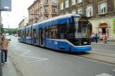 Kraków low-floor articulated tram 2028 on tram line 8 in the square Plac Wolnica (2008).