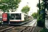 Lille low-floor articulated tram 08 on tram line T at the stop Buisson (2002).