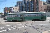 Philadelphia railcar 1053 on San Francisco tourist line F-Market & Wharves in the intersection The Embarcadero/Don Chee Way (2010).
