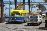San Francisco railcar 1010 on tourist line F-Market & Wharves in the intersection The Embarcadero/Don Chee Way (2010).