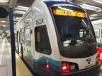 Seattle articulated tram 162 on regional line Link Light Rail at the stop Pioneer Square (2020)