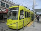 Seattle low-floor articulated tram 403 on tram line South Lake Union at the stop 5th & Jackson (Japantown) (2016)