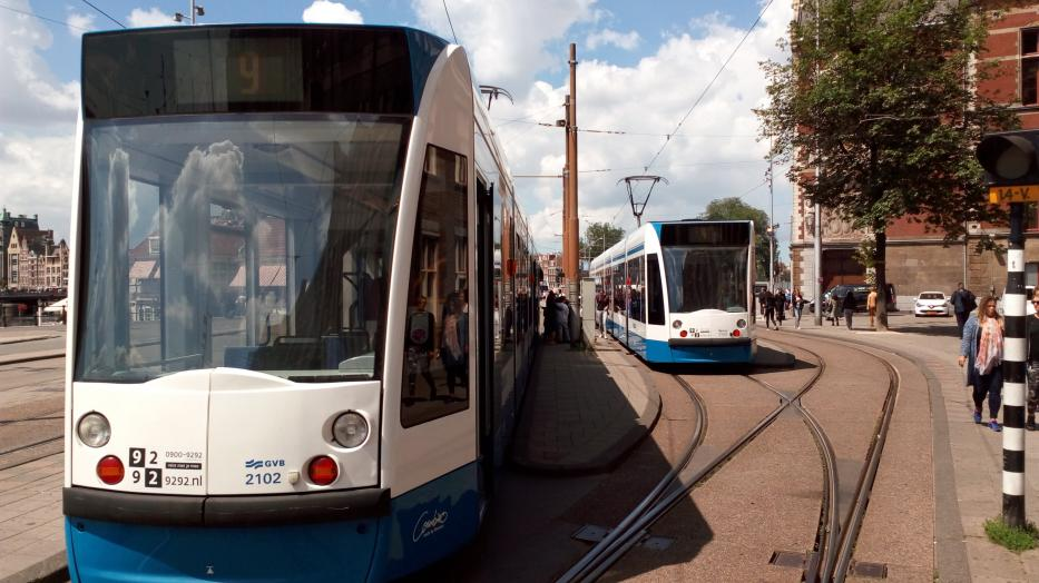 Amsterdam low-floor articulated tram 2102 on tram line 9 at the terminus Centraal Station (2016).