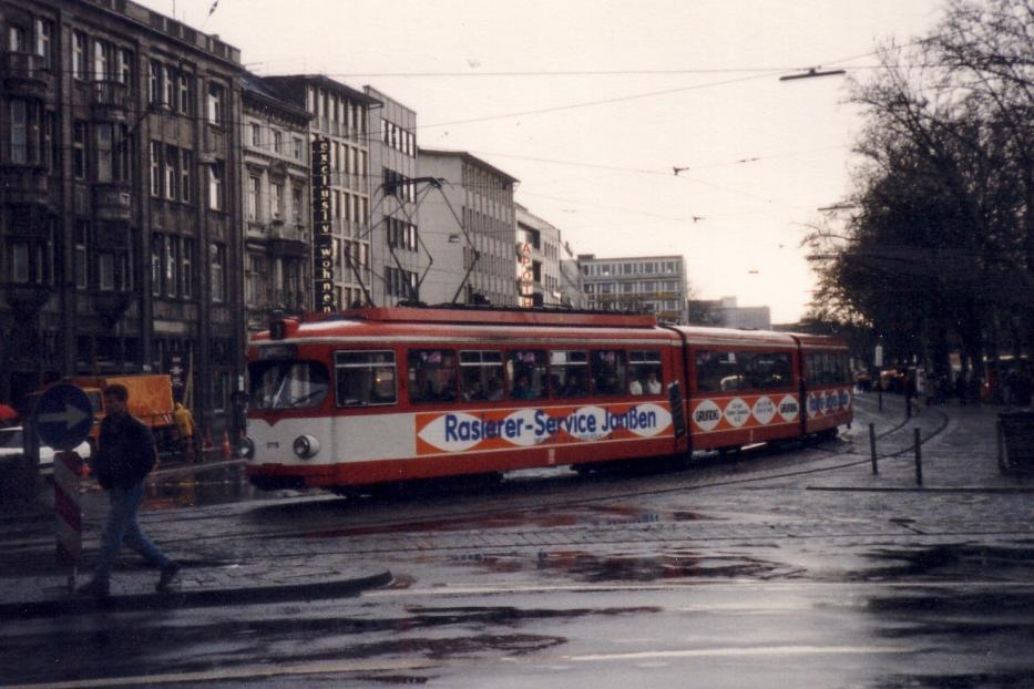 Cologne articulated tram 3778 on tram line 1 in the square Neumarkt (1988).