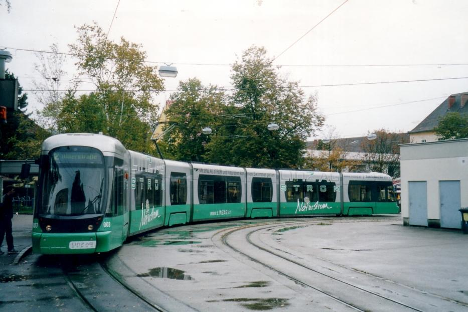 Linz low-floor articulated tram 003 on tram line 2 at the terminus Universität (2004). The image forming decommission the logo for Tram Travels.