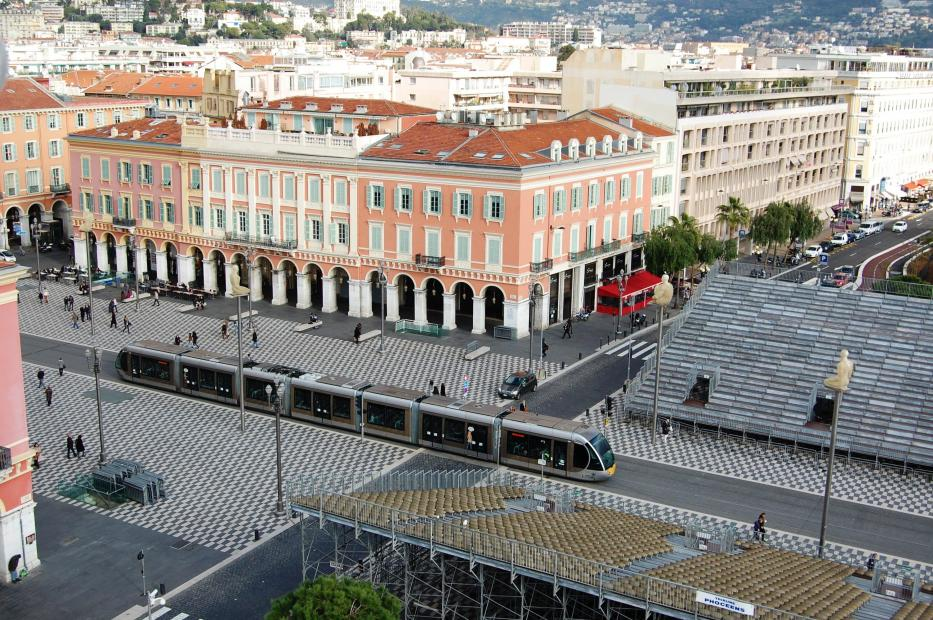 Nice low-floor articulated tram 026 on tram line 1 in the square Place Massena (2014).