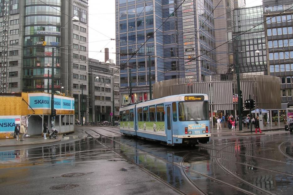 Oslo articulated tram 109 on tram line 12 in the square Jernbanetorget (2010).