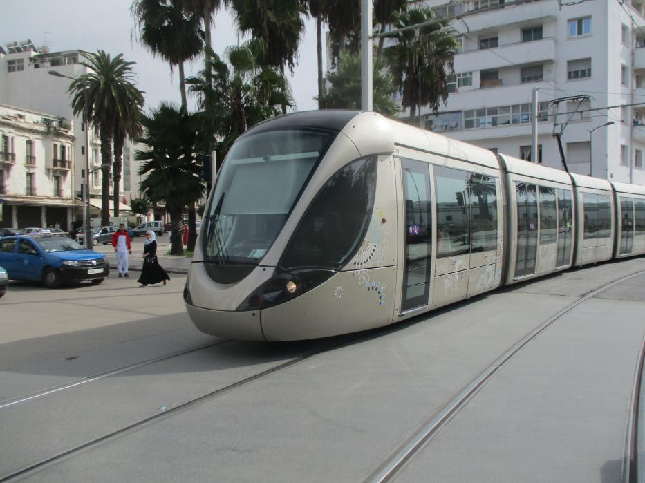 Rabat low-floor articulated tram 019 on tram line L2 in the square Place Melillia (2018).